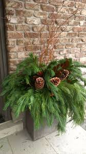 Garden Decorations For Christmas by Best 25 Christmas Planters Ideas On Pinterest Outdoor Christmas