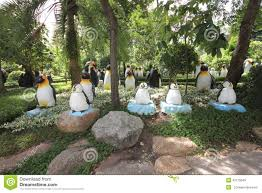 Nong Nooch Tropical Botanical Garden by A Meadow With Penguins And Grass And Trees And Stones In The Nong