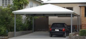 small modern carport applied on the grey concrete floor with small affordable cream house with modern carport that has white pole and roof can add the elegant