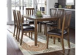 puluxy dining room table and chairs set of 7 ashley furniture