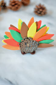 thanksgiving crafts for how to make a pinecone turkey