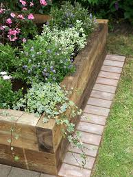 The Proper Way To Make A Bed How To Make A Raised Bed Landscape Timbers Landscaping And Gardens
