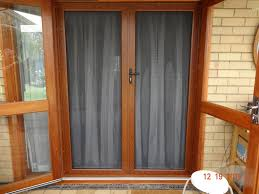 French Security Doors - security french hinged screen doors steel mesh woodgrain finish