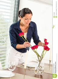 young woman arranging flowers dinner table stock image image