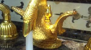 18k 24k gold swan faucet spitting out water from it u0027s mouth into