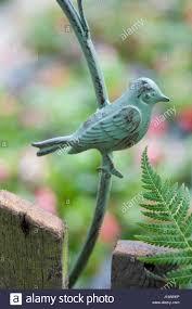 metal bird garden ornament in garden stock photo royalty