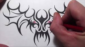 drawing a tribal skull with wings design