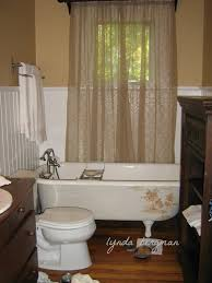 Wainscoting Bathroom Ideas Bathroom Black Clawfoot Tubs With Bathtub Caddy And Wainscoting