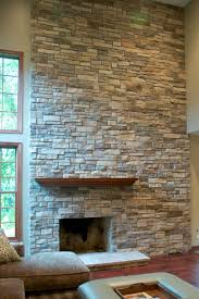 interior stylish floor to ceiling stone veneer fireplace design