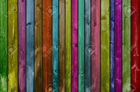 many colorful wooden boards as background cheerful stock photo
