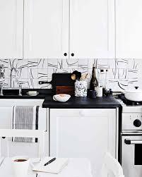 fantastic design of the white tile backsplash with cabinets black