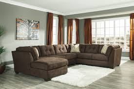 Cindy Crawford Rugs Furniture Grey Armless Loveseat With Animal Rug And Ottoman For