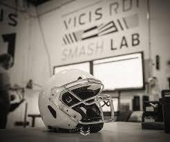 flexible football helmet absorbs hits like a car bumper could put
