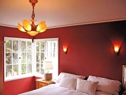 red wall paint in modern house bedroom colors with chandelier