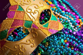 green mardi gras mask a background made up of a gold mardi gras mask and blue purple