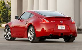 nissan small sports car nissan z reviews nissan z price photos and specs car and driver
