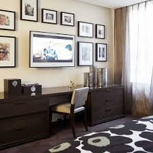 home office with tv mounted tv two dressers with a wood top can serve as a desk