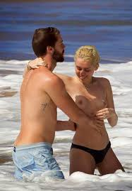 sexy nude miley cyrus miley cyrus topless on the beach with her boyfriend trace