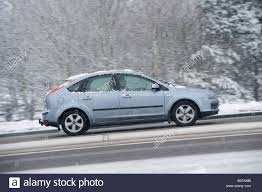 family car side view side view of a car driving along a snow covered road on a winters