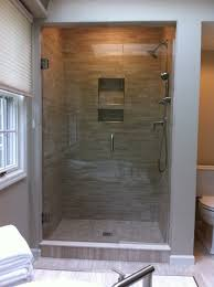 remodeled and updated shower with porcelain mosaic tile recessed