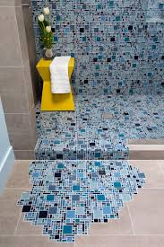 blue glass mosaic tile with puddling effect on floor hgtv new