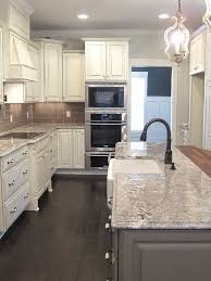 distressed island kitchen white glazed cabinets minka lighting bianco antico granite subway