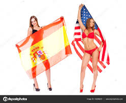 young woman holding a large transparent spanish flag u2014 stock photo