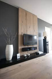 creative tv mounts creative tv wall mount ideas with hard wood panels background also