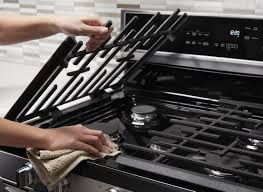 what is the best thing to clean kitchen cabinets with how to clean stove burners and grates whirlpool