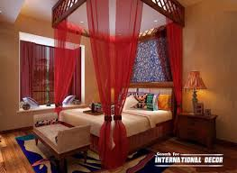 sey bedroom ideas with canopy bed and red sheer curtains comforter