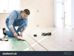 Installing Laminated Flooring Male Worker Installing Laminate Flooring Stock Photo 599521034