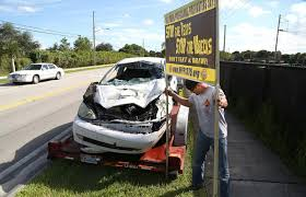firefighters use wrecked car to display danger of texting and