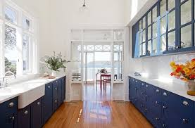 cobalt blue glass front kitchen cabinets marble countertops