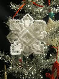 a handmade snowflake ornament glitter fabric yarn