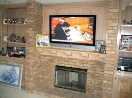 mounting a tv over fireplace mounting above brick fireplace hiding wires beautiful decoration also add over mounting a tv over fireplace