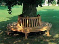 wrap around tree bench good idea for the back yard it even has