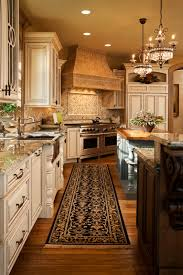 40 uber luxurious custom contemporary kitchen designs home twin chandeliers hang over one of two islands in this richly detailed kitchen natural hardwood