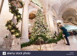 christmas tree and holiday decorations in the astor hall of the