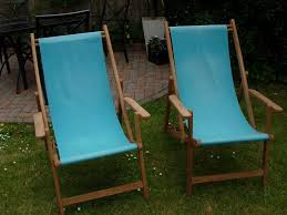 two turquoise habitat retro vintage style wooden deck chairs
