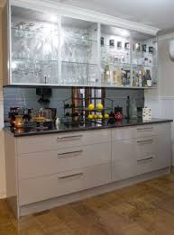 buffet bar glass overhead cabinet doors smoked mirror splashback