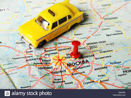 moscow russia map up of moscow russia map and taxi stock photo royalty