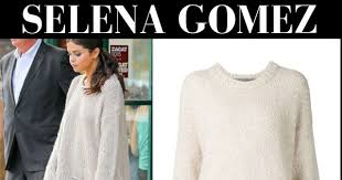 selena gomez in cream oversized sweater and white flared pants in