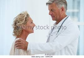 Doctor Comforting Patient Physicians Comforting Stock Photos U0026 Physicians Comforting Stock