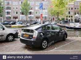 toyota europe charging hybrid car outdoor europe amsterdam toyota prius stock