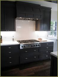 kitchen recessed lighting design with black wooden kitchen