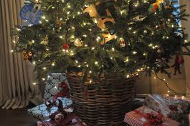 nine sixteen putting a fresh christmas tree in a basket