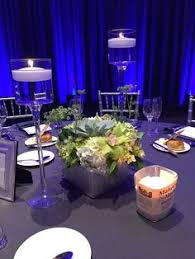 Purple Floating Candles For Centerpieces by Casa Linda Florals Centerpiece With Submerged Spray Roses And