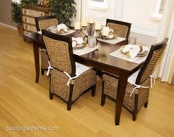 modern dining room design with mango wood dining chairs and glass