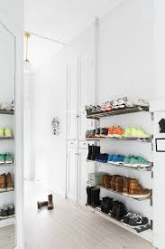 scandinavian home entryway shoe storage white hallway and storage