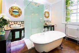 round vanity mirror installed in the bathroom over navy blue